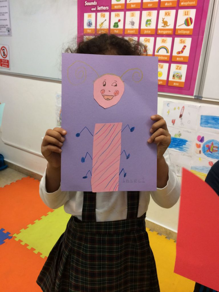 A young learner in her English class learning phonics